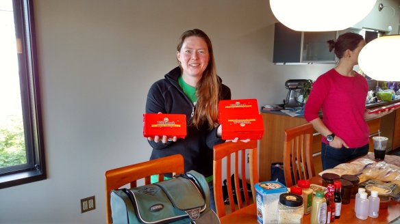 Carolyn with our big blocks of cheese, on day 1 of the epic packing weekend!